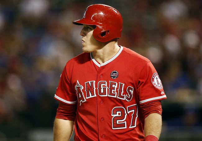 Sep 27, 2013; Arlington, TX, USA; Los Angeles Angels designated hitter Mike Trout (27) reacts after striking out against the Texas Rangers during the seventh inning at Rangers Ballpark in Arlington. The Rangers won 5-3. Mandatory Credit: Jim Cowsert-USA TODAY Sports