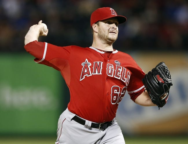 Sep 27, 2013; Arlington, TX, USA; Los Angeles Angels relief pitcher Ryan Brasier (62) delivers to the Texas Rangers during the eighth inning at Rangers Ballpark in Arlington. The Rangers won 5-3. Mandatory Credit: Jim Cowsert-USA TODAY Sports