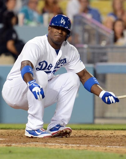 Sep 27, 2013; Los Angeles, CA, USA; Los Angeles Dodgers right fielder Yasiel Puig (66) grimaces in pain after he fouled a ball off of his foot in the fifth inning of the game against the Colorado Rockies at Dodger Stadium. Puig left the game. Mandatory Credit: Jayne Kamin-Oncea-USA TODAY Sports