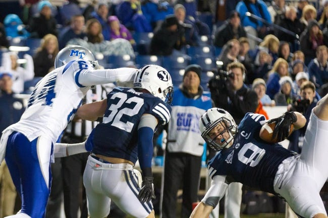 Sep 27, 2013; Provo, UT, USA; Brigham Young Cougars defensive back Daniel Sorensen (9) intercepts a pass in front of teammate Mike Hague (32) and Middle Tennessee Blue Raiders wide receiver Terry Pettis (84) during the second half at Lavell Edwards Stadium. Brigham Young won 37-10. Mandatory Credit: Russ Isabella-USA TODAY Sports