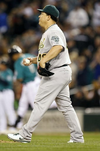 Sep 27, 2013; Seattle, WA, USA; Oakland Athletics pitcher Bartolo Colon (40) walks back to the mound after surrendering a solo-home run to Seattle Mariners designated hitter Kendrys Morales (8) during the sixth inning at Safeco Field. Mandatory Credit: Joe Nicholson-USA TODAY Sports