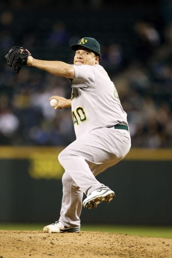 Sep 27, 2013; Seattle, WA, USA; Oakland Athletics pitcher Bartolo Colon (40) throws against the Seattle Mariners during the third inning at Safeco Field. Mandatory Credit: Joe Nicholson-USA TODAY Sports