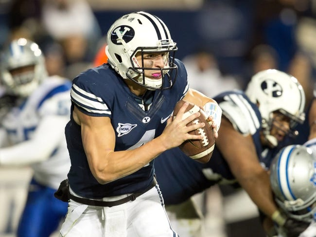 Sep 27, 2013; Provo, UT, USA; Brigham Young Cougars quarterback Taysom Hill (4) scrambles during the second half against the Middle Tennessee Blue Raiders at Lavell Edwards Stadium. Brigham Young won 37-10. Mandatory Credit: Russ Isabella-USA TODAY Sports