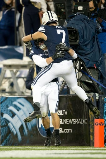 Sep 27, 2013; Provo, UT, USA; Brigham Young Cougars defensive back Skye PoVey (7) celebrates with wide receiver JD Falslev (12) after Falslev scored a touchdown during the second half against the Middle Tennessee Blue Raiders at Lavell Edwards Stadium. Brigham Young won 37-10. Mandatory Credit: Russ Isabella-USA TODAY Sports
