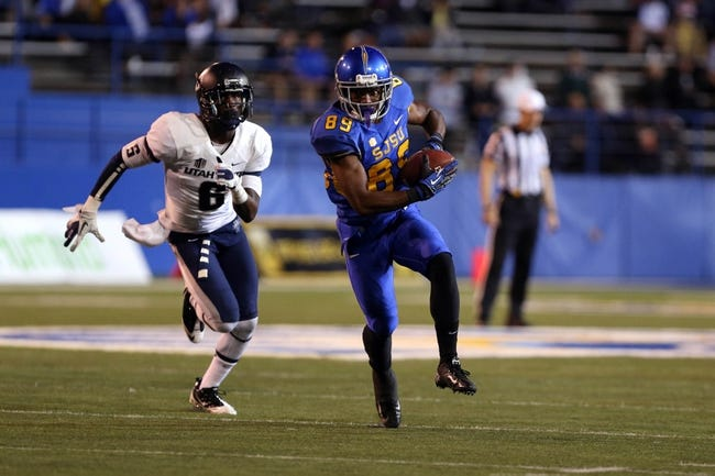 Sep 27, 2013; San Jose, CA, USA; San Jose State Spartans wide receiver Chandler Jones (89) carries the ball ahead of Utah State Aggies cornerback Rashard Stewart (6) during the third quarter at Spartan Stadium. The Utah State Aggies defeated the San Jose State Spartans 40-12. Mandatory Credit: Kelley L Cox-USA TODAY Sports