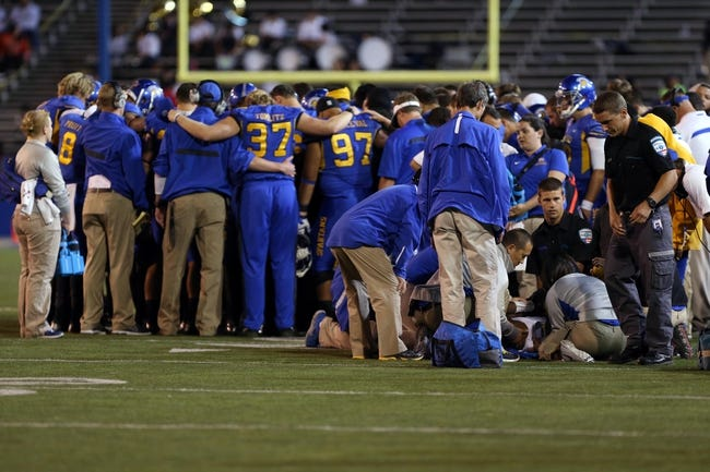 Sep 27, 2013; San Jose, CA, USA; San Jose State Spartans huddle as medical staff tend to San Jose State Spartans cornerback Bene Benwikere (21) during the third quarter against the Utah State Aggies at Spartan Stadium. The Utah State Aggies defeated the San Jose State Spartans 40-12. Mandatory Credit: Kelley L Cox-USA TODAY Sports