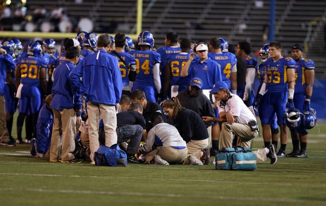Sep 27, 2013; San Jose, CA, USA; Medical staff tend to San Jose State Spartans cornerback Bene Benwikere (21) during the third quarter against the Utah State Aggies at Spartan Stadium. The Utah State Aggies defeated the San Jose State Spartans 40-12. Mandatory Credit: Kelley L Cox-USA TODAY Sports