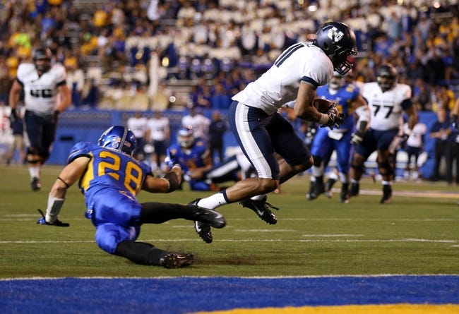 Sep 27, 2013; San Jose, CA, USA; Utah State Aggies wide receiver Brandon Swindall (11) catches the ball for a touchdown against San Jose State Spartans safety Simon Connette (28) during the third quarter at Spartan Stadium. The Utah State Aggies defeated the San Jose State Spartans 40-12. Mandatory Credit: Kelley L Cox-USA TODAY Sports