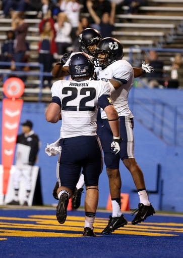 Sep 27, 2013; San Jose, CA, USA; Teammates surround Utah State Aggies wide receiver Brandon Swindall (11) after scoring a touchdown against the San Jose State Spartans during the third quarter at Spartan Stadium. The Utah State Aggies defeated the San Jose State Spartans 40-12. Mandatory Credit: Kelley L Cox-USA TODAY Sports