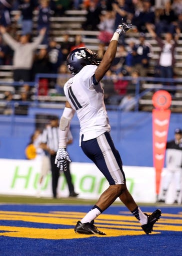 Sep 27, 2013; San Jose, CA, USA; Utah State Aggies wide receiver Brandon Swindall (11) celebrates after a touchdown against the San Jose State Spartans during the third quarter at Spartan Stadium. The Utah State Aggies defeated the San Jose State Spartans 40-12. Mandatory Credit: Kelley L Cox-USA TODAY Sports