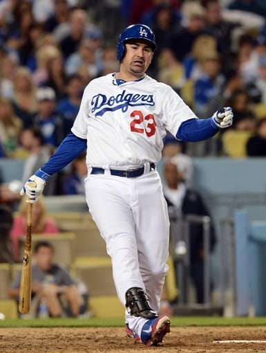 Sep 27, 2013; Los Angeles, CA, USA; Los Angeles Dodgers first baseman Adrian Gonzalez (23) at bat during the game against the Colorado Rockies at Dodger Stadium. Dodgers won 11-0. Mandatory Credit: Jayne Kamin-Oncea-USA TODAY Sports