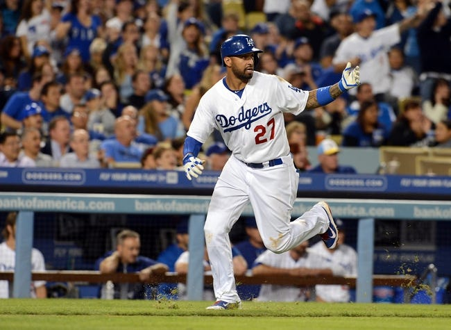 Sep 27, 2013; Los Angeles, CA, USA; Los Angeles Dodgers center fielder Matt Kemp (27) scores a run in the sixth inning of the game against the Colorado Rockies at Dodger Stadium. Dodgers won 11-0. Mandatory Credit: Jayne Kamin-Oncea-USA TODAY Sports