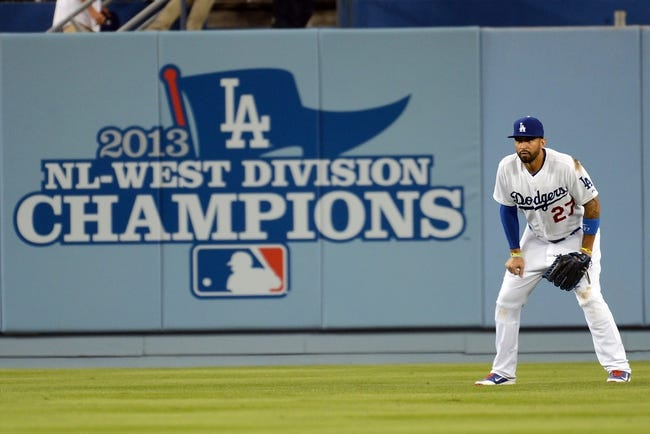 Sep 27, 2013; Los Angeles, CA, USA; Los Angeles Dodgers center fielder Matt Kemp (27) during the game against the Colorado Rockies at Dodger Stadium. Dodgers won 11-0. Mandatory Credit: Jayne Kamin-Oncea-USA TODAY Sports