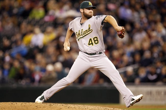 Sep 27, 2013; Seattle, WA, USA; Oakland Athletics pitcher Ryan Cook (48) throws against the Seattle Mariners during the seventh inning at Safeco Field. Mandatory Credit: Joe Nicholson-USA TODAY Sports