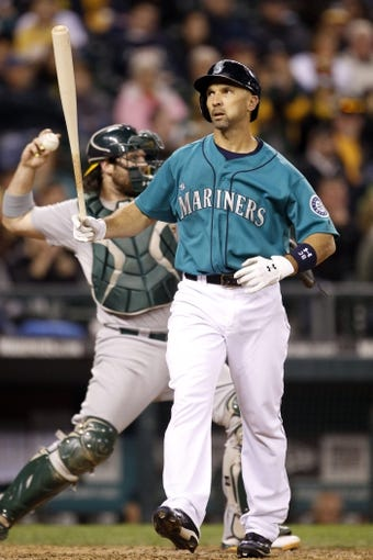 Sep 27, 2013; Seattle, WA, USA; Seattle Mariners left fielder Raul Ibanez (28) strikes out against the Oakland Athletics during the ninth inning at Safeco Field. Mandatory Credit: Joe Nicholson-USA TODAY Sports