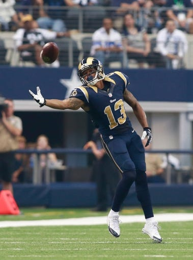 Sep 22, 2013; Arlington, TX, USA; St. Louis Rams wide receiver Chris Givens (13) attempts to catch a pass during the game against the Dallas Cowboys at AT&T Stadium. The Dallas Cowboys beat the St. Louis Rams 31-7. Mandatory Credit: Tim Heitman-USA TODAY Sports