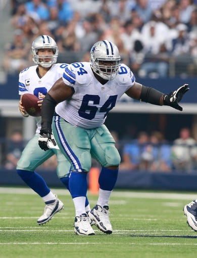 Sep 22, 2013; Arlington, TX, USA; Dallas Cowboys guard Brian Waters (64) on the line of scrimmage during the game against the St. Louis Rams at AT&T Stadium. The Dallas Cowboys beat the St. Louis Rams 31-7. Mandatory Credit: Tim Heitman-USA TODAY Sports