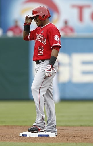 Sep 28, 2013; Arlington, TX, USA; Los Angeles Angels shortstop Erick Aybar (2) reacts after hitting a double off Texas Rangers starting pitcher Derek Holland (not pictured) during the first inning of a baseball game at Rangers Ballpark in Arlington. Mandatory Credit: Jim Cowsert-USA TODAY Sports