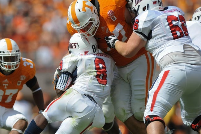 Sep 28, 2013; Knoxville, TN, USA; Tennessee Volunteers defensive lineman Daniel Hood (97) tackles Alabama Jaguars running back Jay Jones (8) during the second quarter at Neyland Stadium. Mandatory Credit: Randy Sartin-USA TODAY Sports