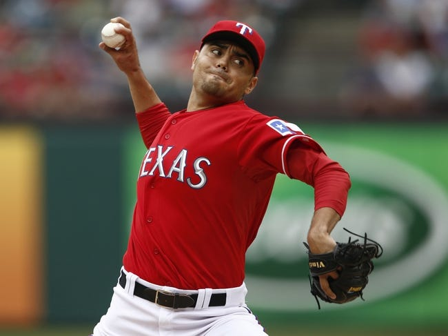 Sep 28, 2013; Arlington, TX, USA; Texas Rangers relief pitcher Joakim Soria (28) delivers a pitch to the Los Angeles Angels during the fifth inning of a baseball game at Rangers Ballpark in Arlington. Mandatory Credit: Jim Cowsert-USA TODAY Sports