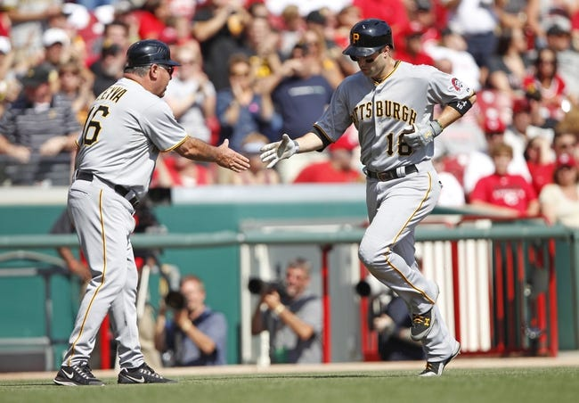 Sep 28, 2013; Cincinnati, OH, USA; Pittsburgh Pirates second baseman Neil Walker (18) is congratulated by third base coach Nick Leyva (16) after hitting a home run during the third inning against the Cincinnati Reds at Great American Ball Park. Mandatory Credit: Frank Victores-USA TODAY Sports