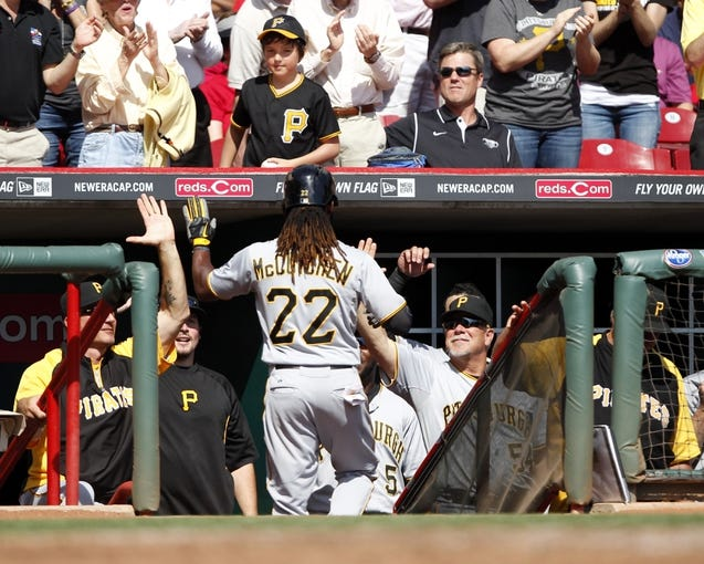 Sep 28, 2013; Cincinnati, OH, USA; Pittsburgh Pirates center fielder Andrew McCutchen (22) is congratulated by team mates after hitting a home run during the third inning against the Cincinnati Reds at Great American Ball Park. Mandatory Credit: Frank Victores-USA TODAY Sports