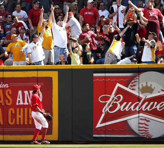 Sep 28, 2013; Cincinnati, OH, USA; Cincinnati Reds center fielder Shin-Soo Choo (17) watches the Pittsburgh Pirates second baseman Neil Walker (not pictured) home run during the third inning at Great American Ball Park. Mandatory Credit: Frank Victores-USA TODAY Sports