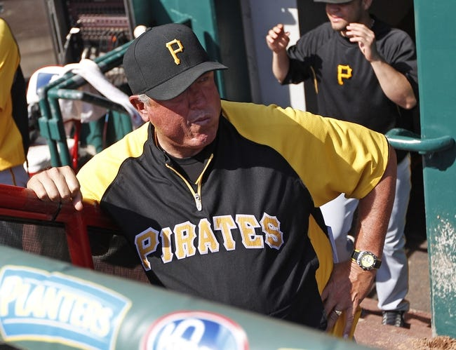 Sep 28, 2013; Cincinnati, OH, USA; Pittsburgh Pirates manager Clint Hurdle (13) in the dugout during the fourth inning against the Cincinnati Reds at Great American Ball Park. Mandatory Credit: Frank Victores-USA TODAY Sports