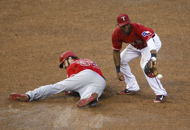 Sep 28, 2013; Arlington, TX, USA; Los Angeles Angels pinch hitter Josh Hamilton (32) slides to second ahead of the throw to Texas Rangers shortstop Elvis Andrus (1) for a double during the ninth inning of a baseball game at Rangers Ballpark in Arlington. Mandatory Credit: Jim Cowsert-USA TODAY Sports
