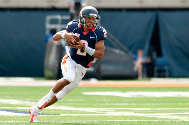Sep 28, 2013; Champaign, IL, USA; Illinois Fighting Illini quarterback Nathan Scheelhaase (2) runs the ball during the third quarter against the Miami Redhawks at Memorial Stadium. Mandatory Credit: Bradley Leeb-USA TODAY Sports