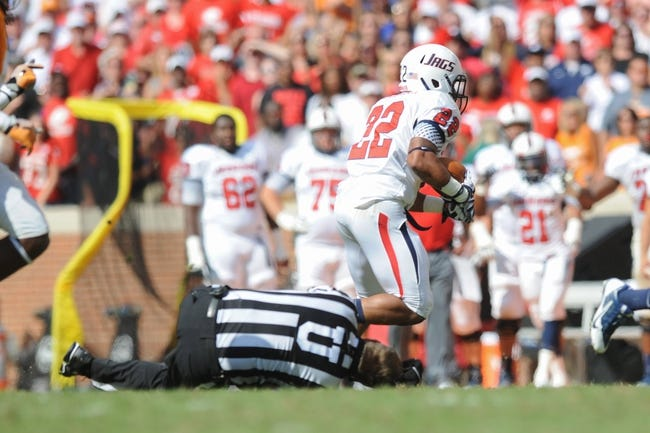 Sep 28, 2013; Knoxville, TN, USA; South Alabama Jaguars running back Cris Dinham (22) runs after running into umpire Rick Lowe during the second half against the Tennessee Volunteers at Neyland Stadium. Tennessee won 31 to 24. Mandatory Credit: Randy Sartin-USA TODAY Sports