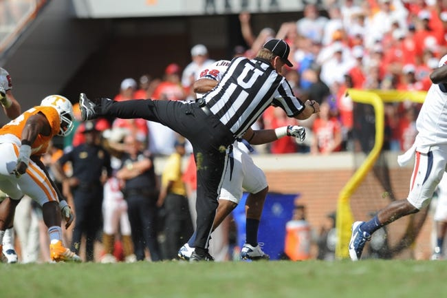 Sep 28, 2013; Knoxville, TN, USA; South Alabama Jaguars running back Cris Dinham (22) runs into umpire Rick Lowe during the second half against the Tennessee Volunteers at Neyland Stadium. Tennessee won 31 to 24. Mandatory Credit: Randy Sartin-USA TODAY Sports
