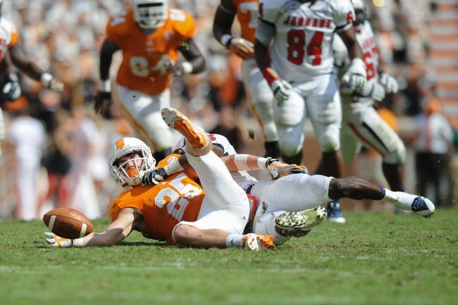 Sep 28, 2013; Knoxville, TN, USA; Tennessee Volunteers wide receiver Josh Smith (25) misses a catch against the South Alabama Jaguars during the second half at Neyland Stadium. Tennessee won 31 to 24. Mandatory Credit: Randy Sartin-USA TODAY Sports