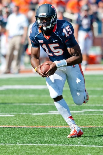 Sep 28, 2013; Champaign, IL, USA; Illinois Fighting Illini quarterback Aaron Bailey (15) runs the ball during the fourth quarter against the Miami (OH) Redhawks at Memorial Stadium. Mandatory Credit: Bradley Leeb-USA TODAY Sports