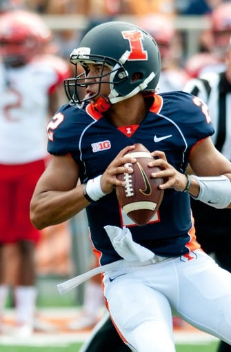 Sep 28, 2013; Champaign, IL, USA; Illinois Fighting Illini quarterback Nathan Scheelhaase (2) looks for an open receiver during the first half against the Miami Redhawks at Memorial Stadium. Mandatory Credit: Bradley Leeb-USA TODAY Sports
