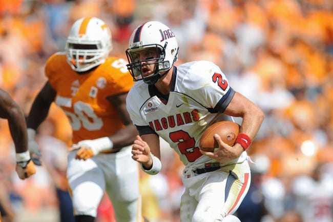 Sep 28, 2013; Knoxville, TN, USA; South Alabama Jaguars quarterback Ross Metheny (2) runs the ball against the Tennessee Volunteers during the second half at Neyland Stadium. Tennessee won 31 to 24. Mandatory Credit: Randy Sartin-USA TODAY Sports