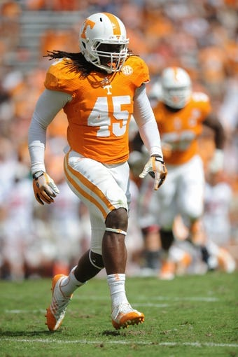 Sep 28, 2013; Knoxville, TN, USA; Tennessee Volunteers linebacker A.J. Johnson (45) during the second half against the South Alabama Jaguars at Neyland Stadium. Tennessee won 31 to 24. Mandatory Credit: Randy Sartin-USA TODAY Sports