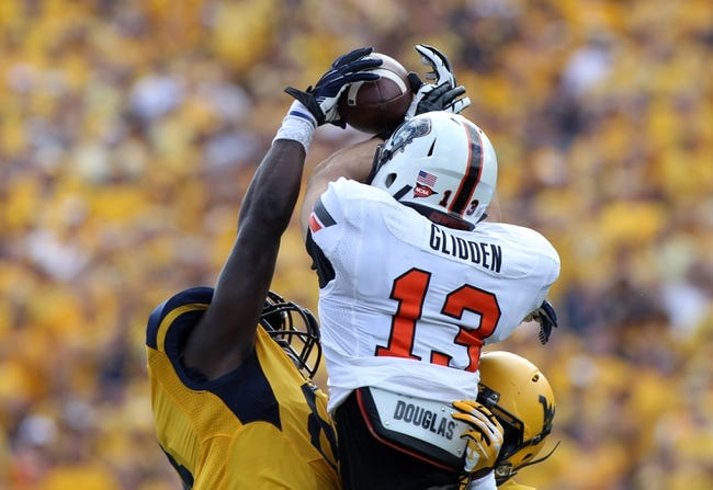 Sep 28, 2013; Morgantown, WV, USA; West Virginia Mountaineers safety Karl Joseph (8) breaks up a pass intended for Oklahoma State Cowboys wide receiver David Glidden (13) at Milan Puskar Stadium. Mandatory Credit: Peter Casey-USA TODAY Sports