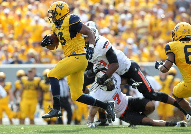 Sep 28, 2013; Morgantown, WV, USA; West Virginia Mountaineers running back Charles Sims (3) runs the ball against the Oklahoma State Cowboys during the second half at Milan Puskar Stadium. Mandatory Credit: Peter Casey-USA TODAY Sports