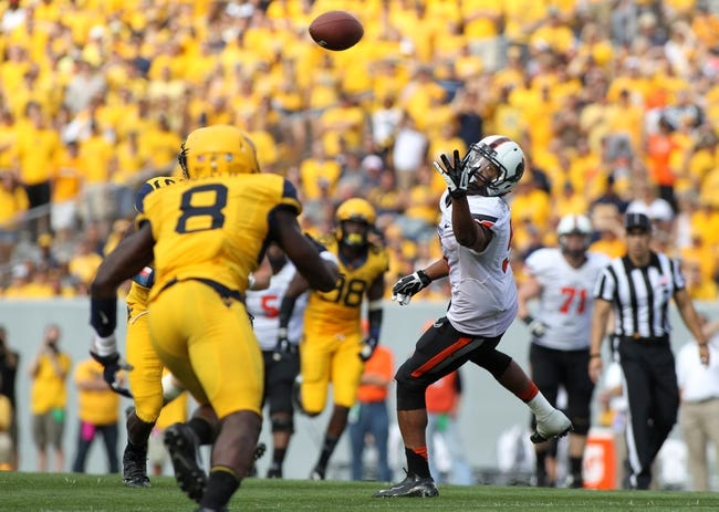 Sep 28, 2013; Morgantown, WV, USA; Oklahoma State Cowboys wide receiver Josh Stewart (5) misses a catch during the fourth quarter against the West Virginia Mountaineers at Milan Puskar Stadium. Mandatory Credit: Peter Casey-USA TODAY Sports