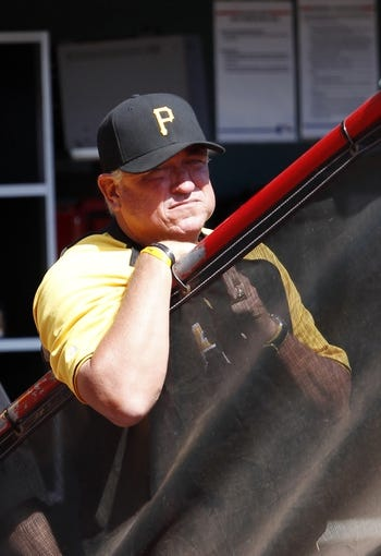 Sep 28, 2013; Cincinnati, OH, USA; Pittsburgh Pirates manager Clint Hurdle (13) in the dugout during the second inning against the Cincinnati Reds at Great American Ball Park. Mandatory Credit: Frank Victores-USA TODAY Sports