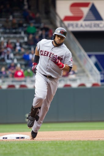 Sep 28, 2013; Minneapolis, MN, USA; Cleveland Indians catcher Carlos Santana (41) rounds third base after his home run in the fourth inning against the Minnesota Twins at Target Field. Mandatory Credit: Brad Rempel-USA TODAY Sports