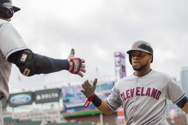 Sep 28, 2013; Minneapolis, MN, USA; Cleveland Indians catcher Carlos Santana (41) is congratulated by Cleveland Indians shortstop Asdrubal Cabrera (13) after his home run in the fourth inning against the Minnesota Twins at Target Field. Mandatory Credit: Brad Rempel-USA TODAY Sports