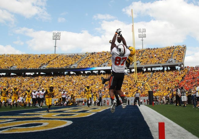 Sep 28, 2013; Morgantown, WV, USA; West Virginia Mountaineers cornerback Travis Bell (26) breaks up a pass in the end zone for Oklahoma State Cowboys wide receiver Tracy Moore (87) during the second half at Milan Puskar Stadium. Mandatory Credit: Peter Casey-USA TODAY Sports