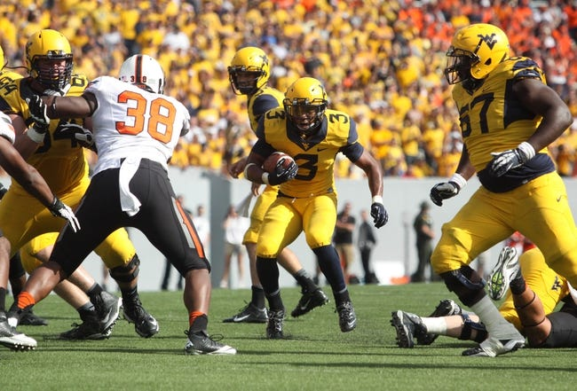 Sep 28, 2013; Morgantown, WV, USA; West Virginia Mountaineers running back Charles Sims (3) runs the ball during the second half against the Oklahoma State Cowboys at Milan Puskar Stadium. Mandatory Credit: Peter Casey-USA TODAY Sports