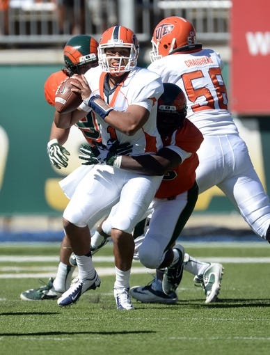 Sep 28, 2013; Fort Collins, CO, USA; Miners quarterback Jameill Showers (1) is sacked by Colorado State Rams linebacker Shaquil Barrett (56) in the first quarter at Hughes Stadium. Mandatory Credit: Ron Chenoy-USA TODAY Sports