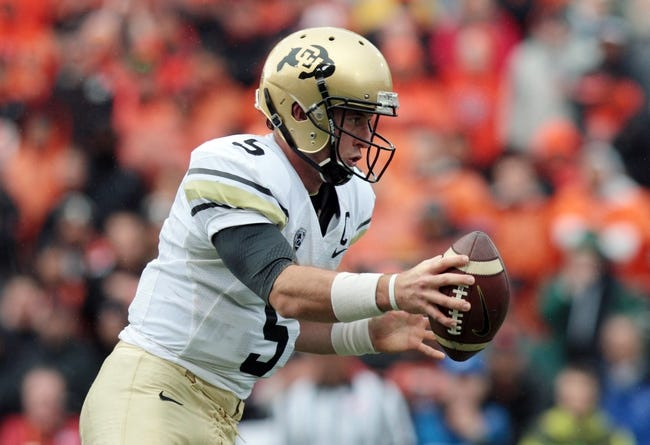 Sep 28, 2013; Corvallis, OR, USA; Colorado Buffaloes quarterback Connor Wood (5) hands the ball off against the Oregon State Beavers at Reser Stadium. Mandatory Credit: Scott Olmos-USA TODAY Sports