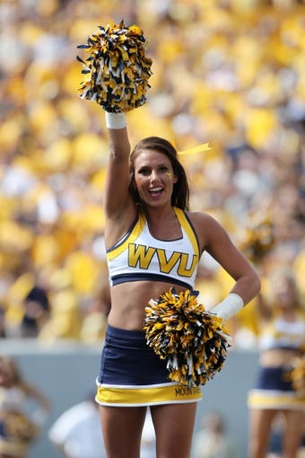 Sep 28, 2013; Morgantown, WV, USA; A West Virginia Mountaineers cheerleader performs during the game against the Oklahoma State Cowboys at Milan Puskar Stadium. Mandatory Credit: Peter Casey-USA TODAY Sports