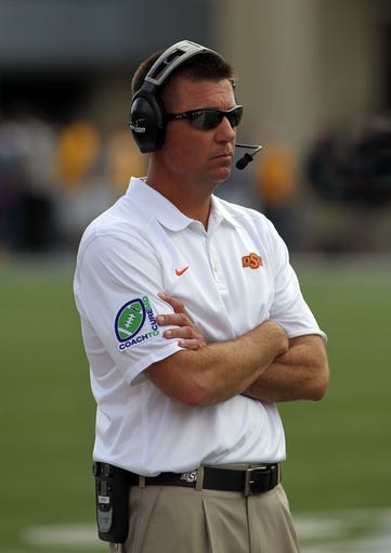 Sep 28, 2013; Morgantown, WV, USA; Oklahoma State Cowboys head coach Mike Gundy during the game against the West Virginia Mountaineers at Milan Puskar Stadium. Mandatory Credit: Peter Casey-USA TODAY Sports