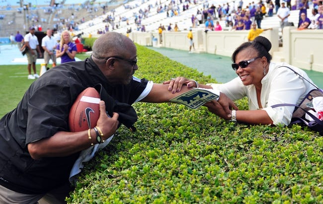 Sep 28, 2013; Chapel Hill, NC, USA;  East Carolina Pirates head coach Ruffin McNeill (left) celebrates a victory over the North Carolina Tarheels with his wife at Kenan Memorial Stadium.  ECU won 55-31. Mandatory Credit: Rob Kinnan-USA TODAY Sports